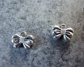 2 silver metal bow charms