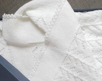 White knitted cotton baby blanket