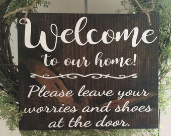 Welcome to our home! Please leave your worries and shoes at the door.  Comes with jute hanger.