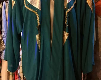 1980' turquoise green long, bat-sleeves jacket, with huge shoulder pads. Size L/XL.