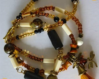 "Bohemian bracelet ""Saffron"" 4 rows, glass beads, seeds, wood beads and resin"