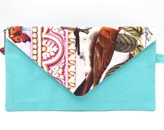 Pochette bleu lagon et imprimé oiseau et papillon