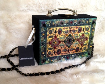 Black leather bag with carpet print