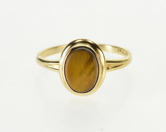 10k Oval Tiger's Eye Bezel Inset Solitaire Ring Gold