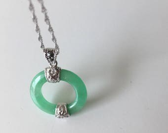 Hollow jade pendant with silver patterns and decorative stones at the top, Chinese jade jewelry, jade-silver pendant