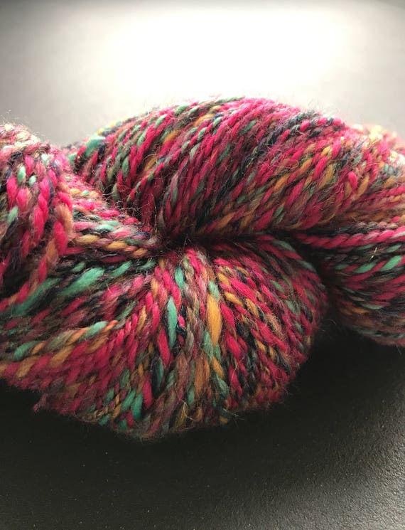 Fine hand spun sockblend yarn 'nightshift' with wool, nylon and angelina glitter fibre in red, pink, green, yellow, dark blue