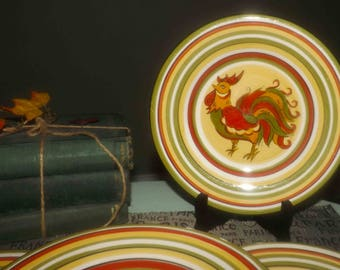 Vintage (c.1995) Tabletops Gallery Rafael Rooster salad plate. Hand-painted red, green, orange, yellow stripes, Rafael Rooster in center.