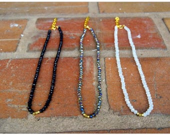 Black beaded choker with little gold beads