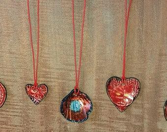 ceramic pendants on leather chord