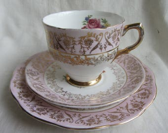 Pretty vintage Springfield trio. Fine bone china tea cup saucer & plate. Pink and gilt chintz with floral sprays. Tea party, wedding