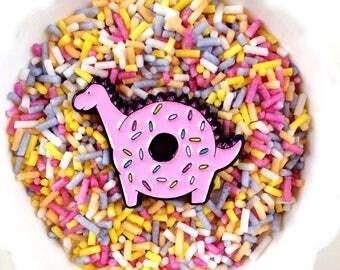 Donutosaur - donut dinosaur enamel pin. Cute pink doughnut dino with sprinkles. Kawaii pin badge.