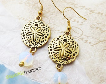 Beachy Dreams - sand dollar dangle earrings, gold alloy charms, iridescent stone beads, shell