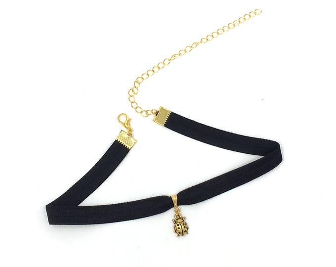 LOVE BUG: black elastic gold ladybug choker
