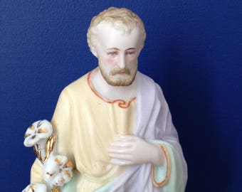 French antique bisque porcelain statue of Saint Joseph holding flowers.