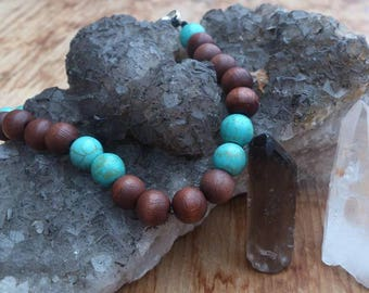 Fair trade wood and turquoise bead bracelet