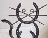Cat made from horseshoes. Metal cat kitty pussy cat gift