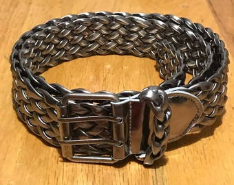 Nice wide belt color silver. It can be used as casual or dressy Fit Small, medium or large.