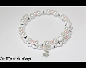 Nursing bracelet on memory wire form of 55mm with glass beads pink and white