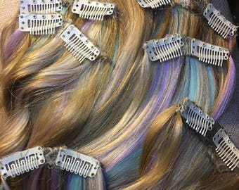 Pastel rainbow, pink, purple, mint blend quadruple weft, 8 piece clip in hair extension set. Free shipping within 24 hours of payment!