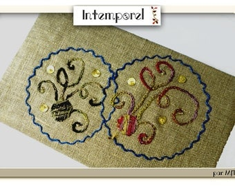 Address book directory and its cover of two circles embroidered on linen gold lame