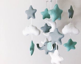 Cute mint grey and white stars or hearts, moon and cloud baby mobile featuring a little elephant