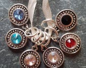 6 knitting or crochet  stitch markers. Jewels