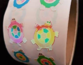 Plastic sticker roll with 50 breaks TURTLE