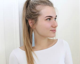 Light blue leather tassel earrings, tassel with silver colour elements