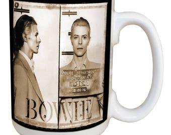 David Bowie Mug. Large 15 ounce coffee mug, comfortable handle. 1975 Rochester Mugshot. Image on both sides Dishwasher & microwave safe.