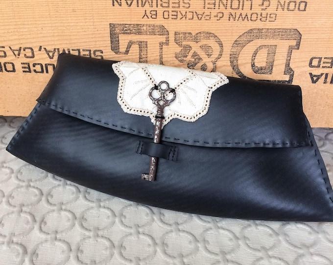 Modern Reclaimed Rubber Clutch - antique key, key fabric lining