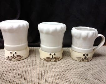 Chef faced salt & pepper/seasoning shaker and coffee cup by unknown mid to late 1900s