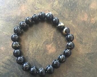 Gold black energy bracelet
