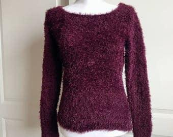 Fuzzy sweater size M