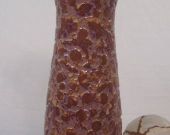 Wheel thrown ceramic vase.For dry flowers use only ,will not hold water.