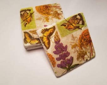 Ceramic coasters botanical look with a bird and butterfly. Set of 4