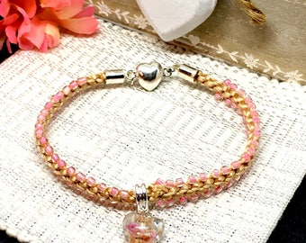 Peachy pink heart braided bracelet, heart focal bead