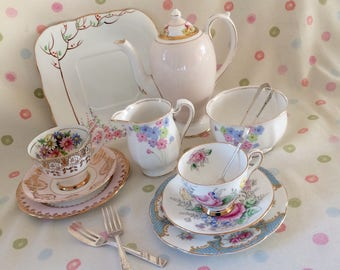 TEA FOR TWO: Gorgeous pink and blue bone china part teaset with coffee pot and cutlery.