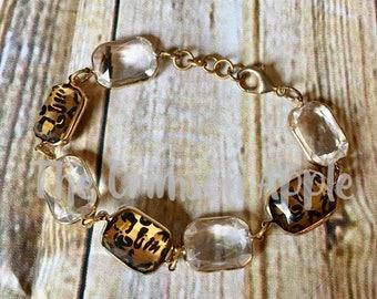 Leopard and clear gold link bracelet