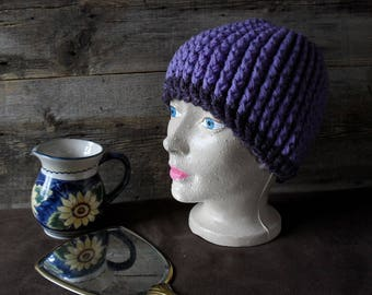 Crochet wool hat in shades of purple and violet, handmade.