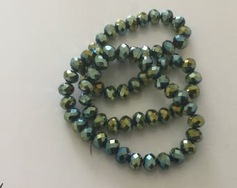 A faceted 8 mm Green AB 8 mm Crystal bead