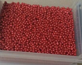 Red glass around 5 mm round bead