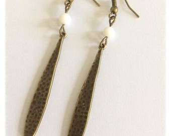 Bronze metal charm long drop shape earrings and Ecru Pearl.