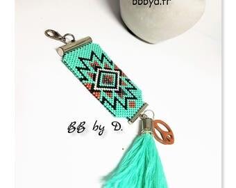 Pendant, jewelry bag, key Miyuki Délicas beads woven by hand. Apricot, Turquoise. Beads, charm, tassel accessory.