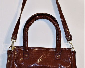 Brown snakeskin printed faux leather bag