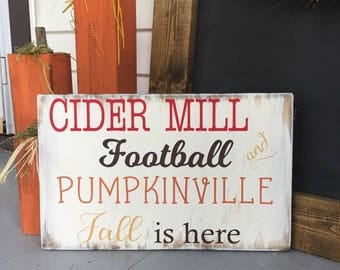 Cider Mill, Football and Pumpkinville wooden sign