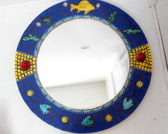"Mirror mosaic."" Yellow fish with scales on blue ""diam.69 cm"