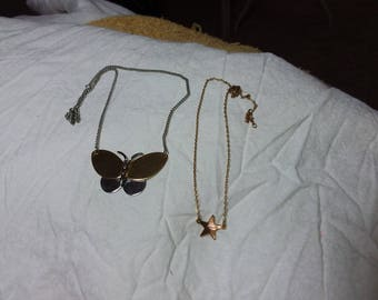 Set of two vintage Avon necklace, one butterfly and one star. Estate found costume jewelry.