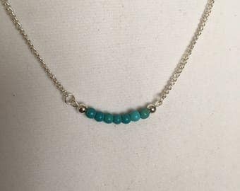 """Turquoise and silver beads on an 18"""" sterling silver chain.  Minimal necklace."""