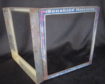 1946 Tin Top Advertising Sunshine Biscuit. Made by Loose-Wiles Biscuit Co.