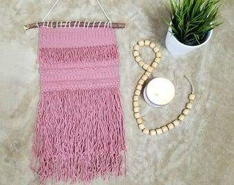 Hand woven wall hanging in pink
